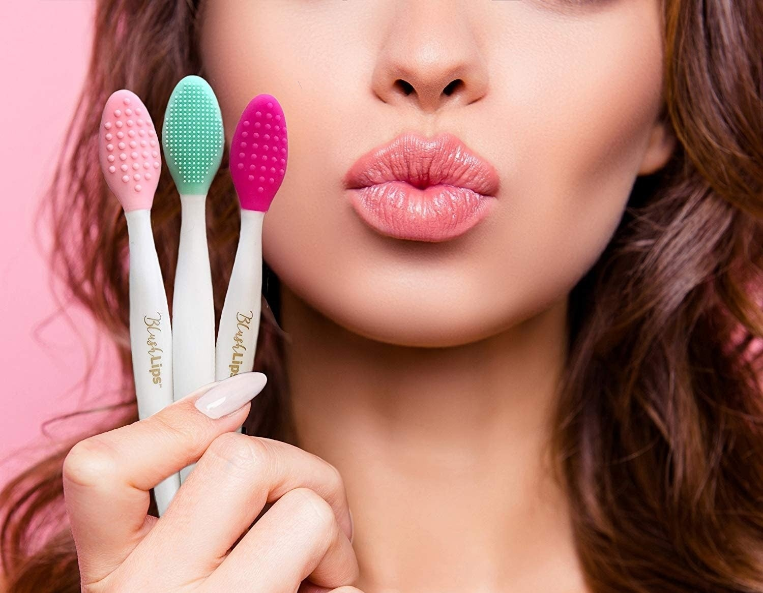 A model holding three scrubber lip brushes