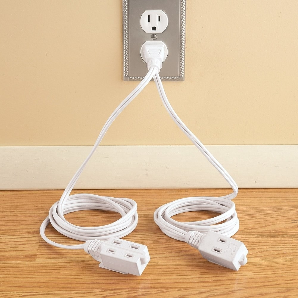 The double-ended extension cord plugged into a wall.
