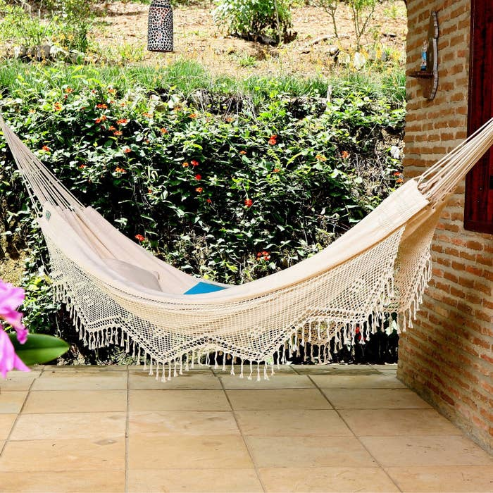 """Promising review: """"We ended up purchasing two of these hammocks. They are large and roomy. Easy to hang up. This hammock would not be considered for camping or backpacking unless you're prepared to carry a heavy load. On the other hand it is perfect for a backyard get away or balcony retreat. Beautiful, sturdy, comfortable and very roomy. This hammock is exactly what what I wanted."""" —RedMolly250Get it on sale from Hayneedle for $95.78 (originally $106.99)."""