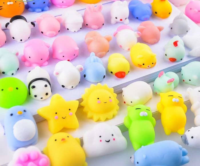 A collection of squishy-looking toys that are each about an inch long. Some shapes include a lion, star, cloud, penguin, and duck