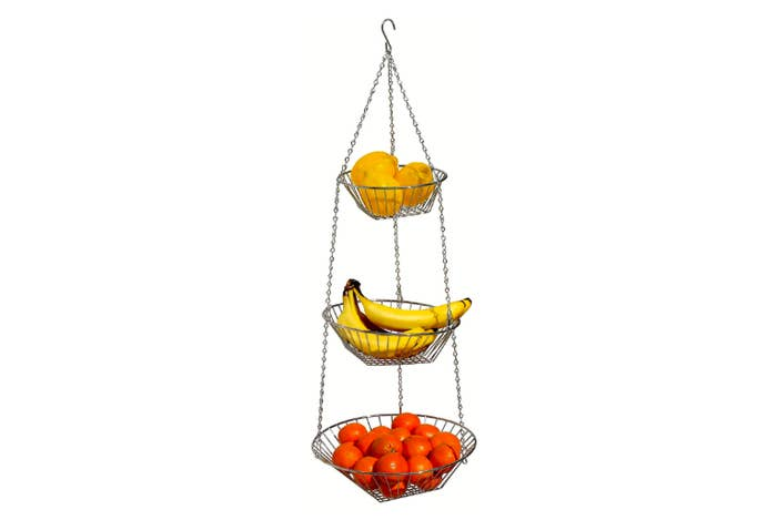 """Promising review: """"This is a great hanging basket. It's well constructed, holds six large potatoes, five large onions, and lots of garlic on the top basket. It has excellent spacing between the baskets. I would recommend it to any cook that require more space. Excellent quality. I would purchase again."""" —Kimberly R. ConleyGet it from Amazon for $13.97."""