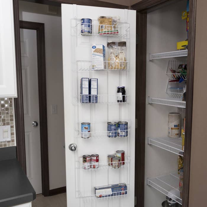 """Promising review: """"This organizer was just what I needed in my new home. I have downsized from a residential house to a condominium and the kitchen storage is tiny. This organizer helps me use the pantry door for my most frequently used items. I would definitely recommend for those with small kitchen storage.""""—Deborah CGet it from Walmart for $18.98."""