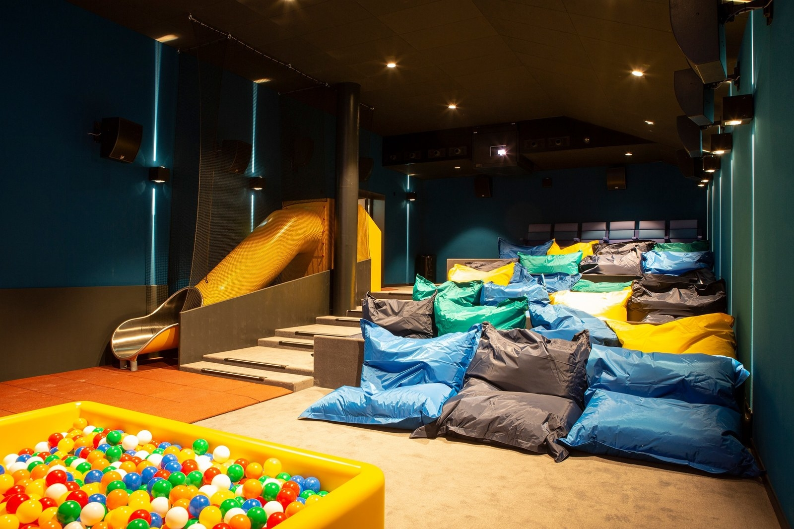 I mean, bean bag chairs! A slide! A ball pit! I'm living for this whole aesthetic. The theater had actual kids submit their ideas so you know it's officially kid-approved.