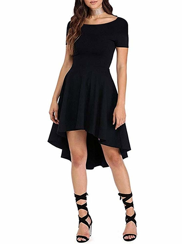 Model wearing the fit and flare dress in black