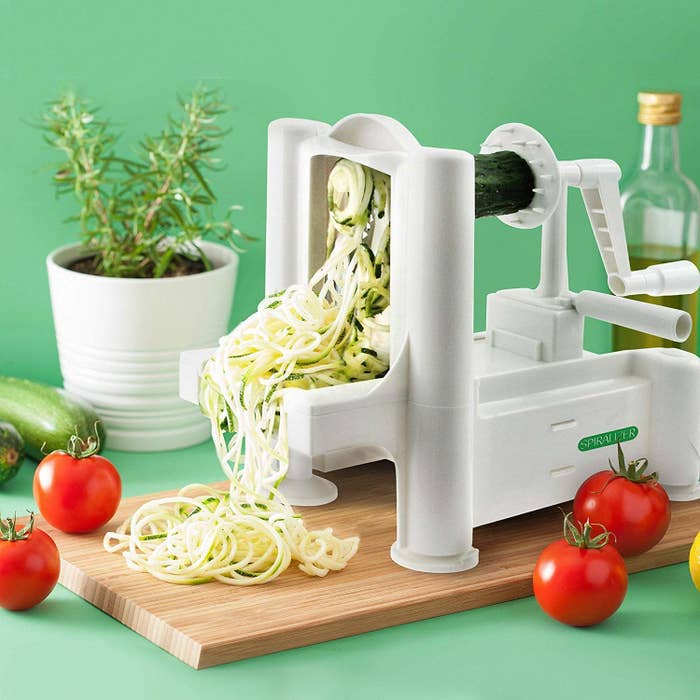 """This spiralizer has 9.8K positive reviews on Amazon, so you know it's the real deal.Promising review: """"Wow this thing works great! When I first got the box I was nervous because it was so light! I knew the majority of this spiralizer was plastic but was still surprised how light if felt. My girlfriend was also skeptical. We put a zucchini in the machine and the rest was history. Whatever weight this thing lacks it makes up for in how well it works. It blew through zucchini, carrots, potatoes and sweet potatoes. We use it to cut thin slices of potatoes so we can bake chips. It also will spiral a whole zucchini into like 10 foot strands of 'pasta.' Very impressed and it just takes a quick rinse under the sink to bring it back to new condition. For the price, buy one! I'm thinking about gifting a few to my family who love to cook."""" —TcollinsGet it from Amazon for $24.98."""