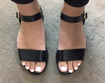 another reviewer in the shoes in black, they have a vertical strap across the front of the toes and an ankle strap with a buckle