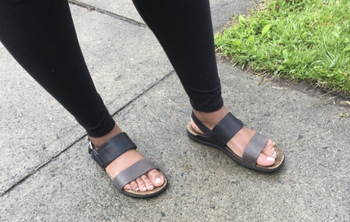 a reviewer in the black and grey sandals