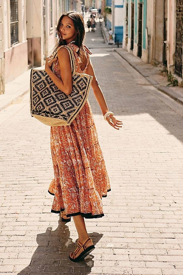 """Promising review: """"This lovely cotton dress is easy to wear, lightweight with a short slip underneath. Cool cotton for hot weather, flowing, and loose fitting. Pair it with a denim jacket and sandals and it's perfect for those cool summer evenings!"""" —RLSMeimeiGet it from Free People for $168 (available in sizes XS-XL and in three colors)."""