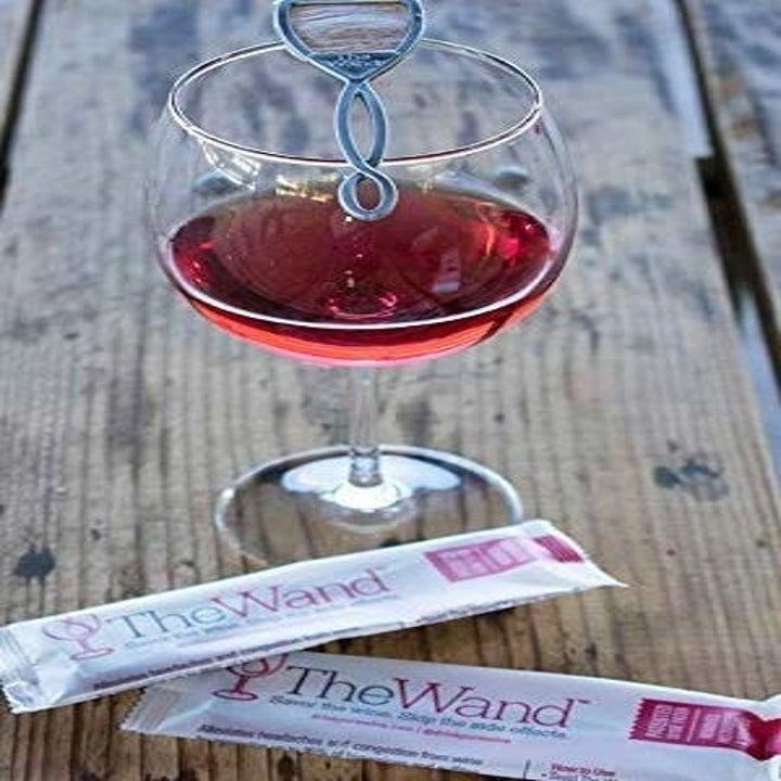 glass of wine with wine wand inside