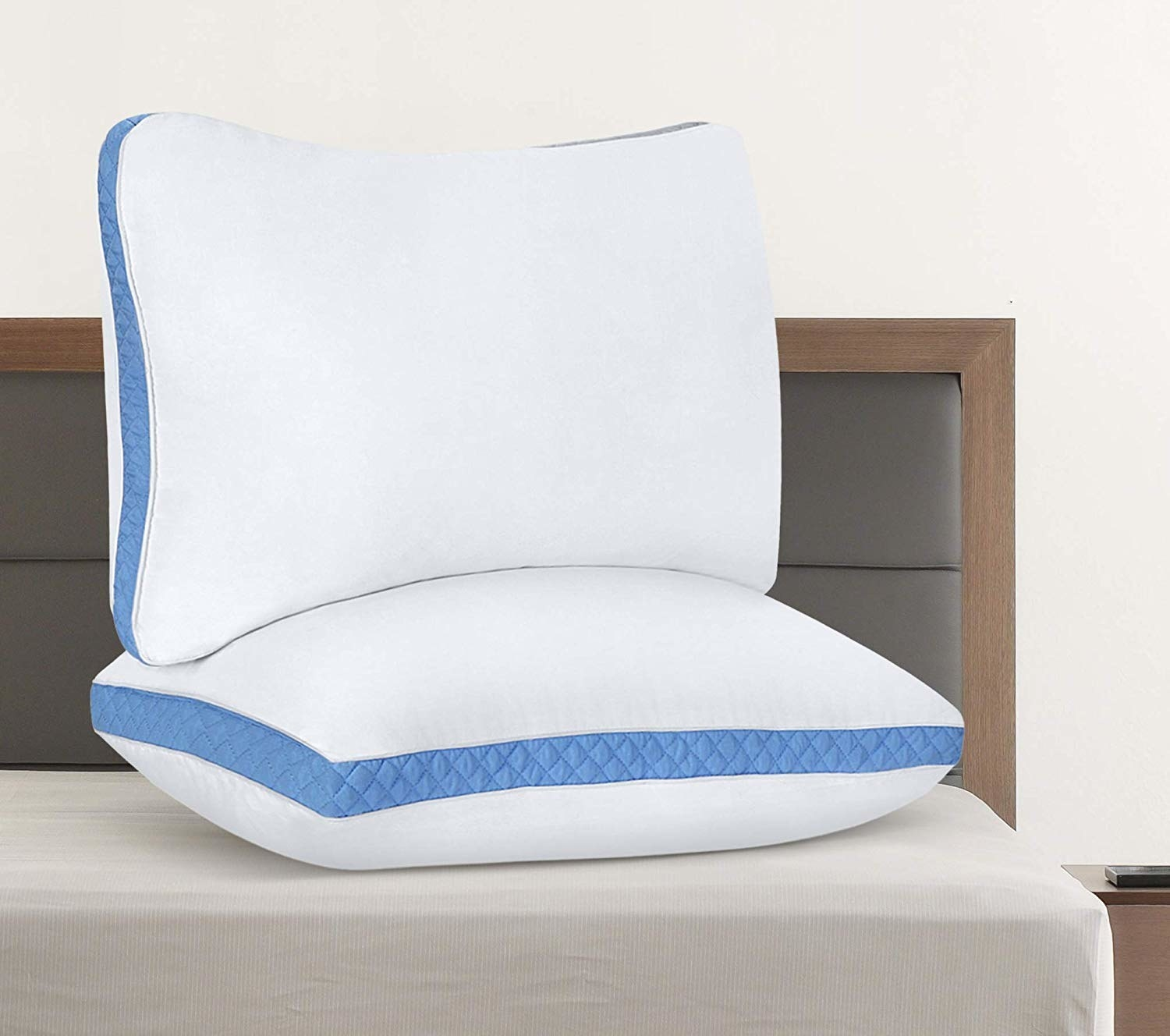 two thick pillows on a bed