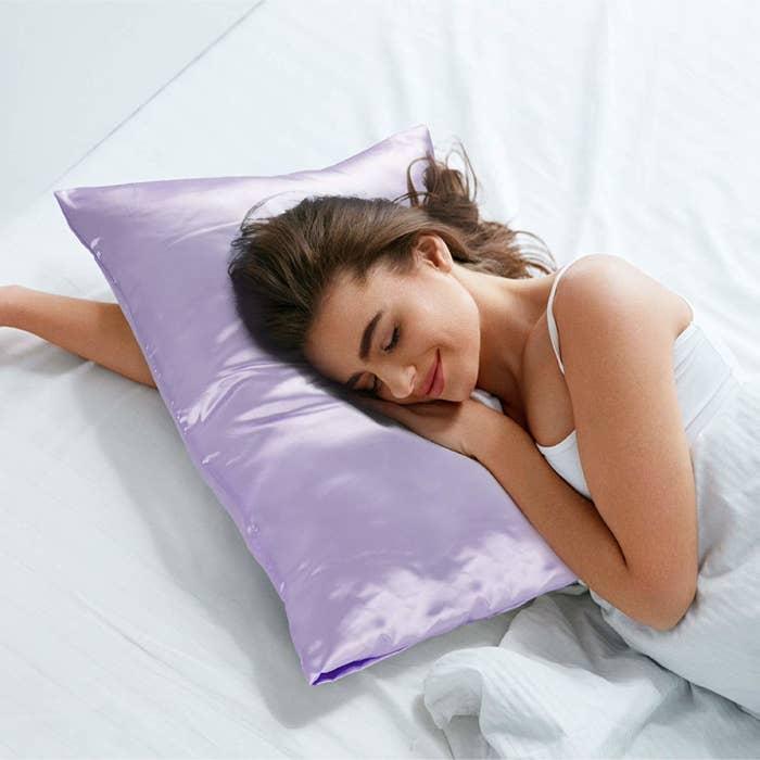 A model sleeping on the shiny lavender pillowcase