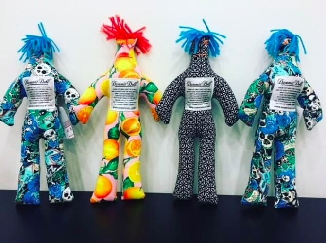 four person-shaped dolls in various fabric patterns