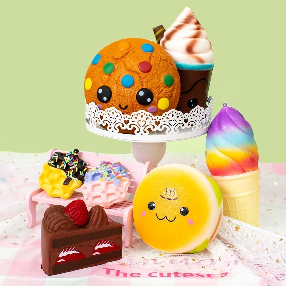 various food-themed squishy toys including cake, ice cream, and cookies