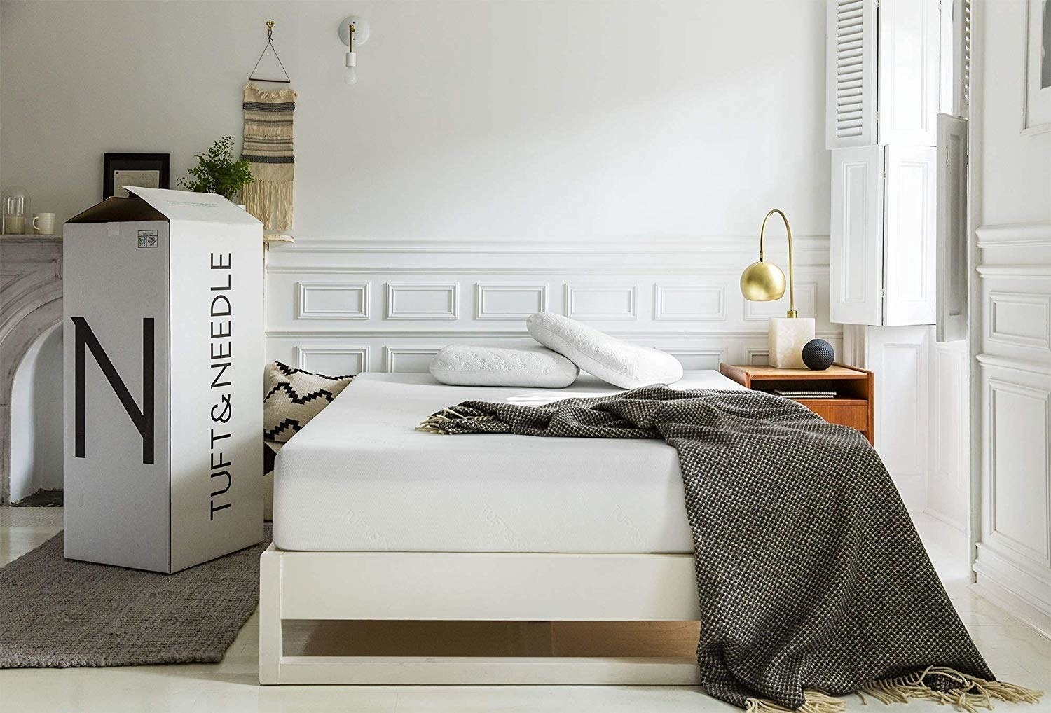 The mattress staged in a room, showing the box it ships in