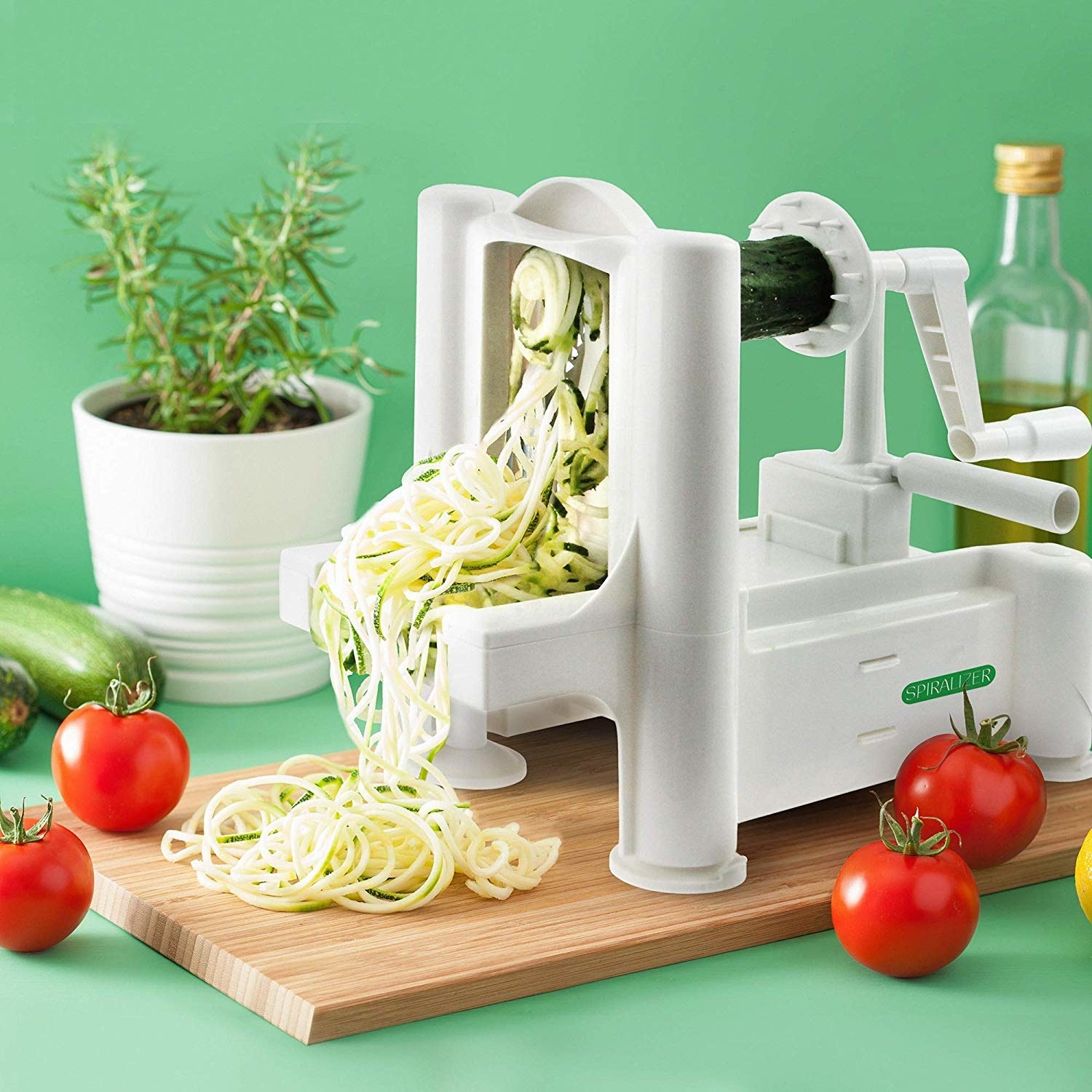 spiralizer spits out zucchini noodles with hand crank