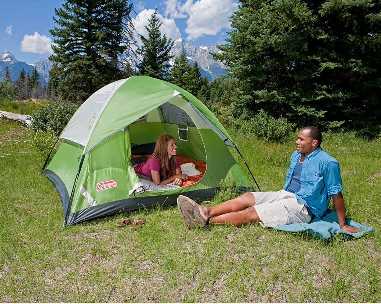 Two models using the four-person tent