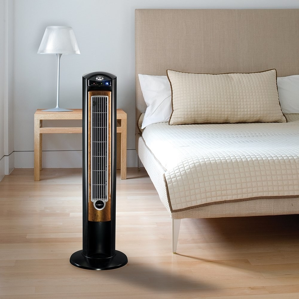 The tall, narrow fan staged in a room