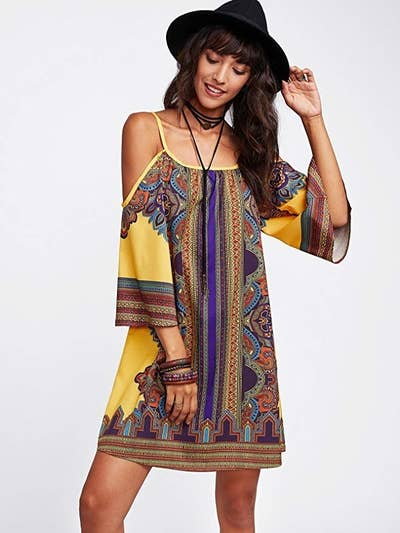2464ad5784d9d A printed, cold-shoulder dress to wear to festivals or just when you want  to stand out from the crowd. Amazon