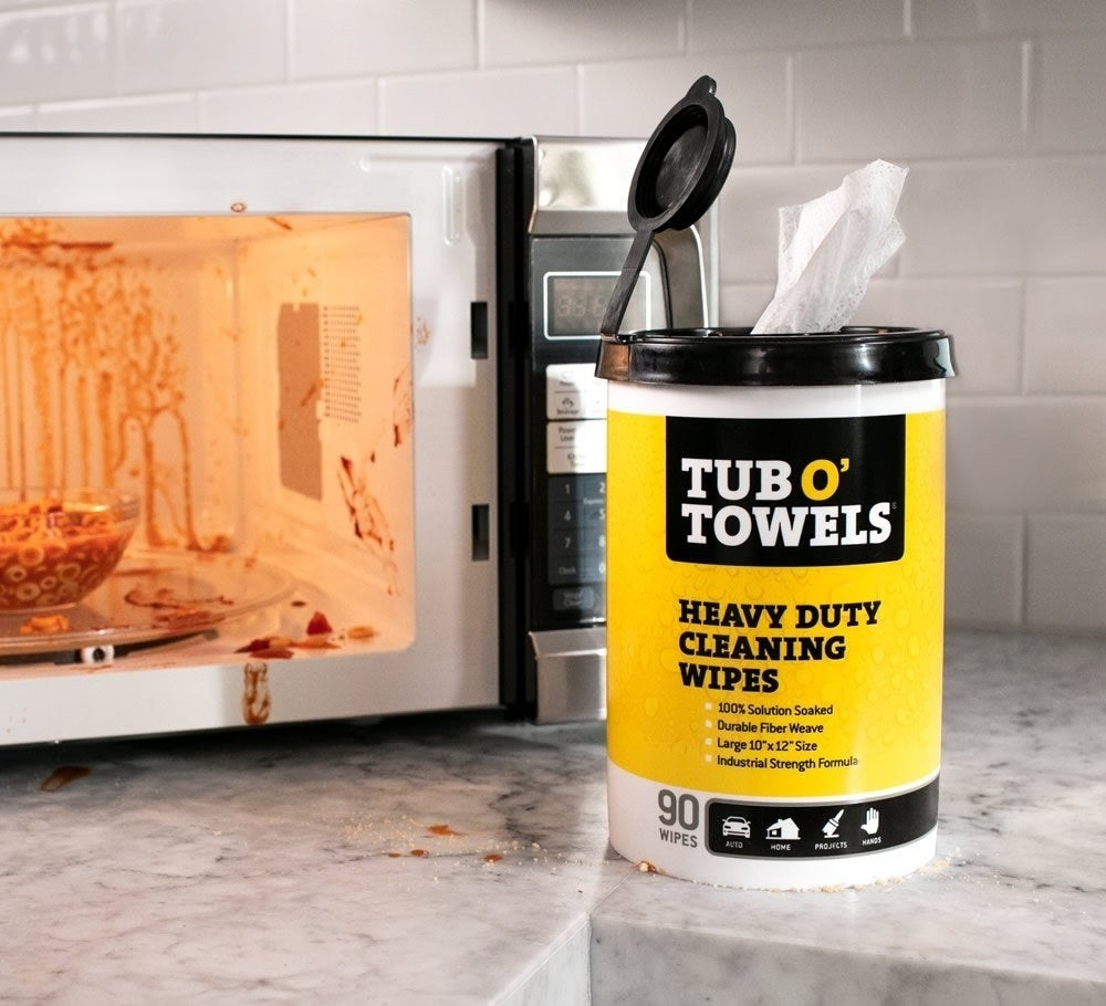 the heavy-duty wipes in front of a dirty microwave
