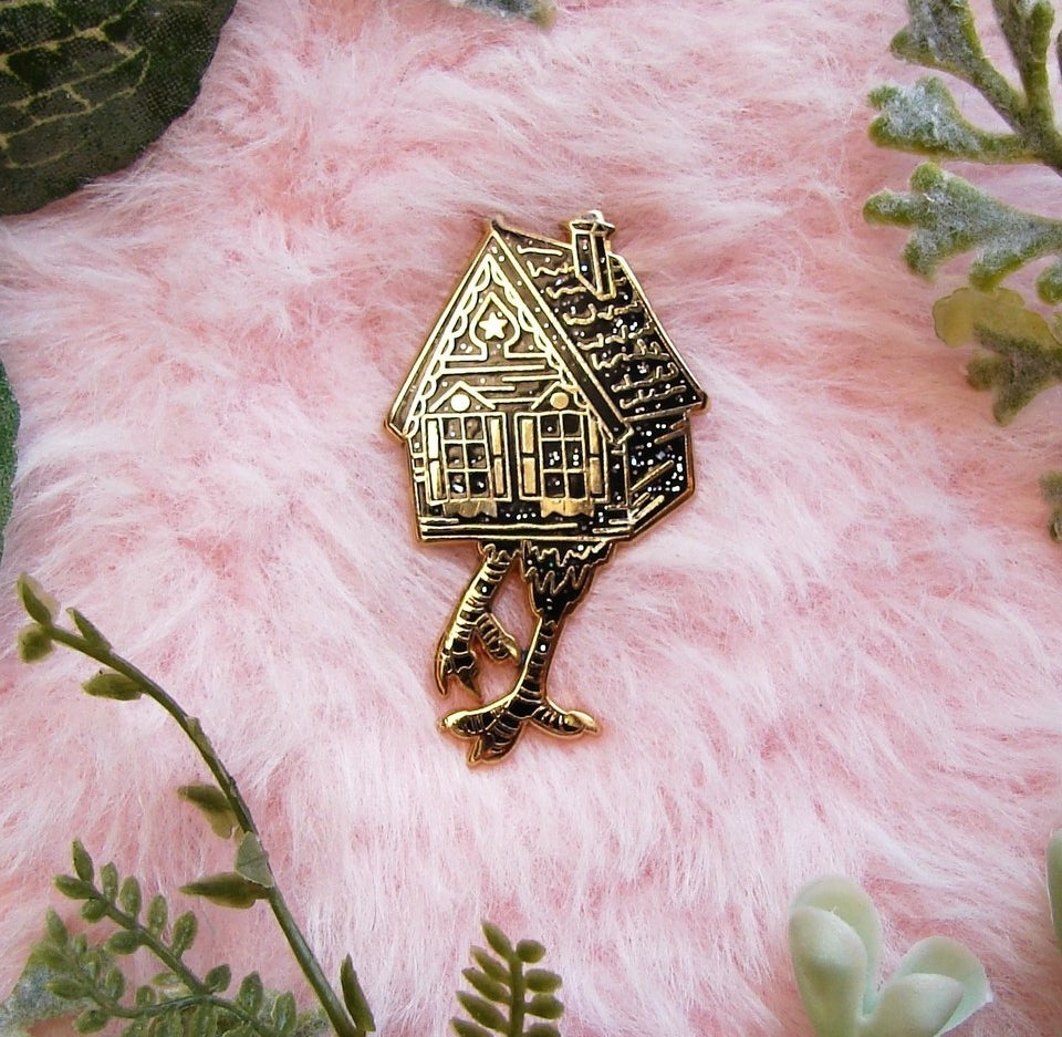 pin shaped like house with chicken legs
