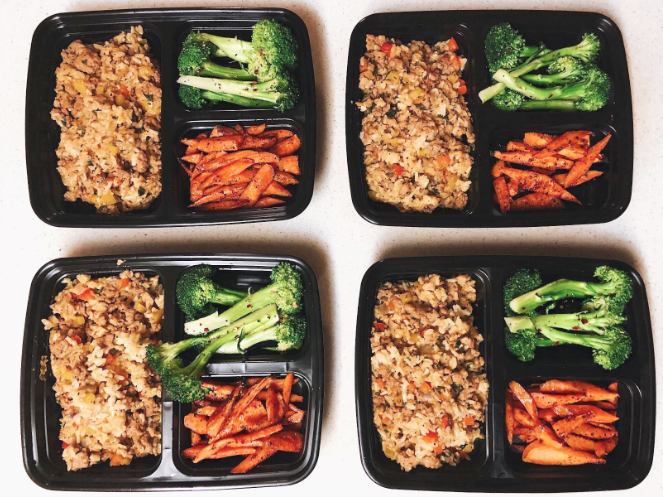 Review image of four meals meal prepped in the containers