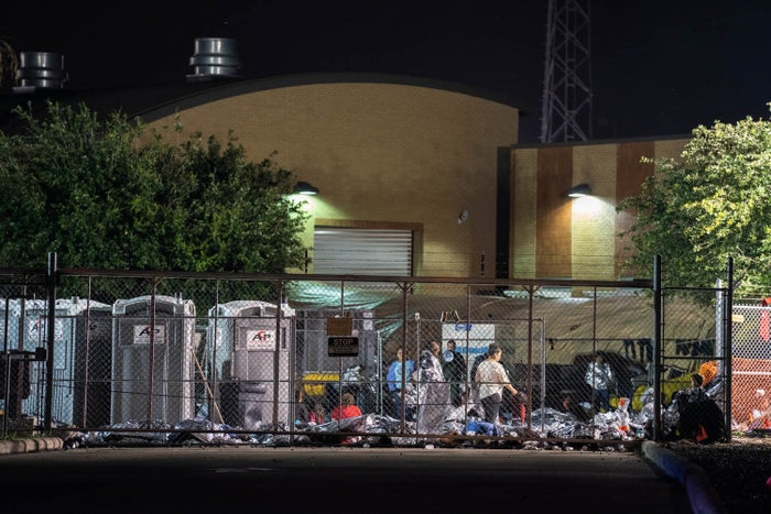 Asylum-seekers wait for their names to be called at 5 a.m. under plastic thermal blankets outside of the Border Patrol station in McAllen, Texas, May 15.