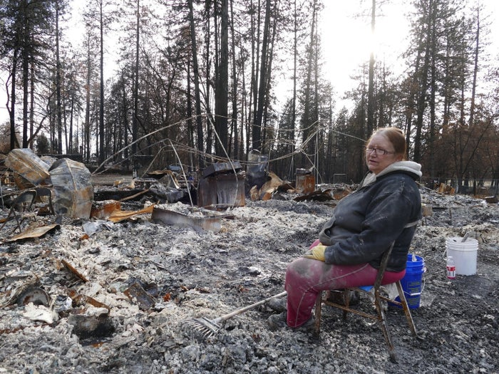Donna Williams sits in the middle of the ruins of the apartment house where she lived for 19 years in Paradise, Dec. 19, 2018.