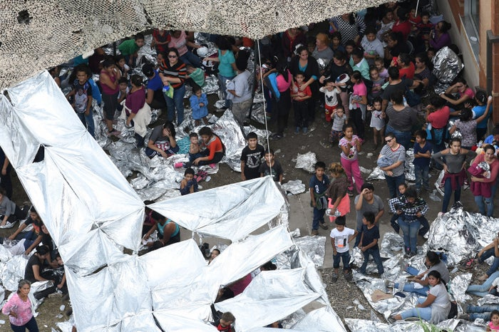 Migrants are seen outside US Border Patrol McAllen Station in a makeshift encampment.