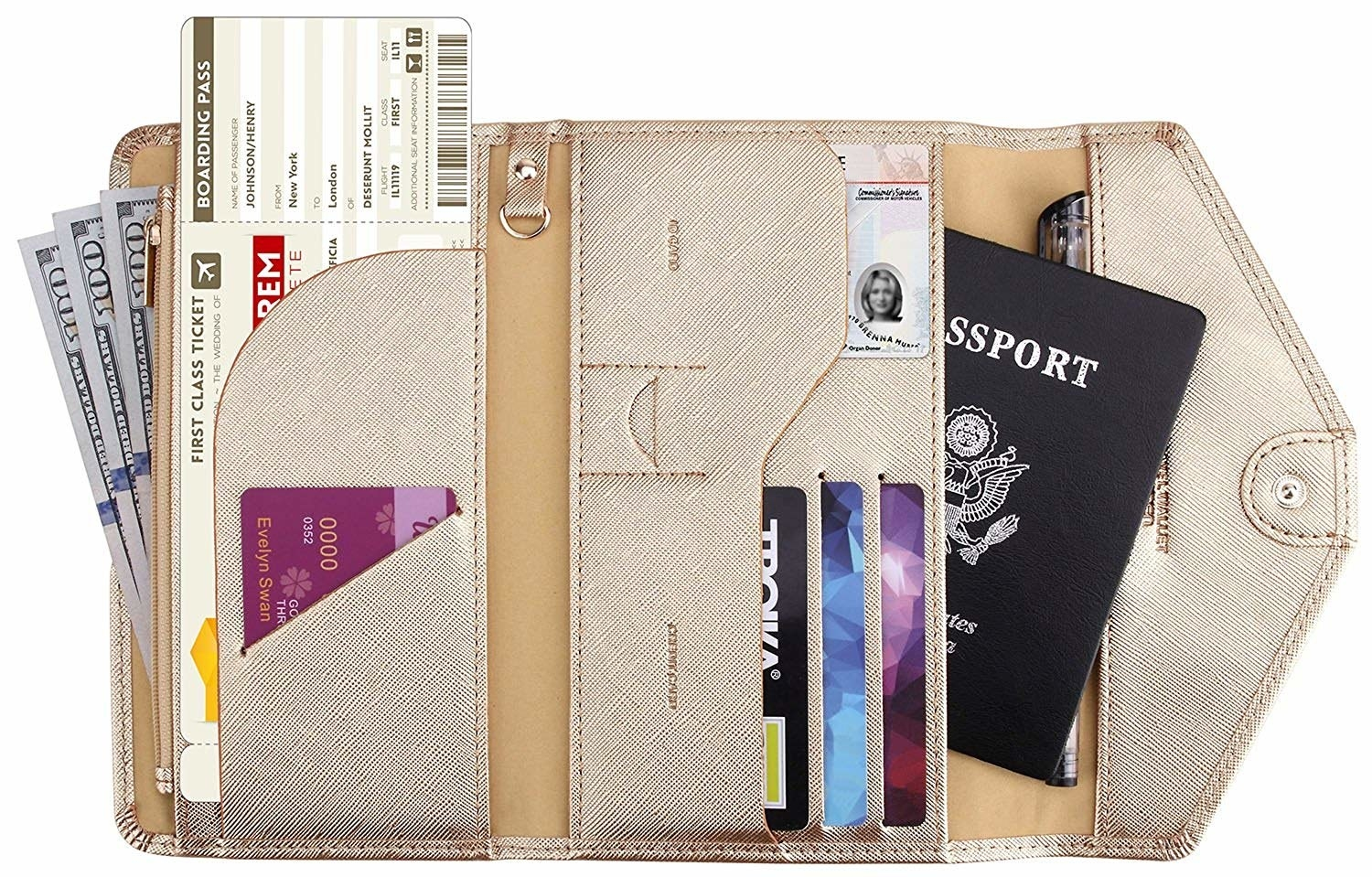 The gold metallic wallet open to show what it holds