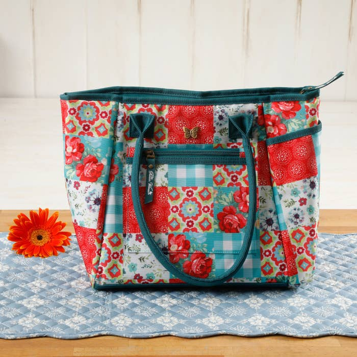 """Promising review: """"This is a super cute lunch tote with plenty of room. The water bottle is a nice addition too. The design is so bright and cheerful. :) I love it. I bought some storage containers to keep in it for sandwiches and snacks, and they fit perfect! —ReadMyLipsPrice: $19.68"""