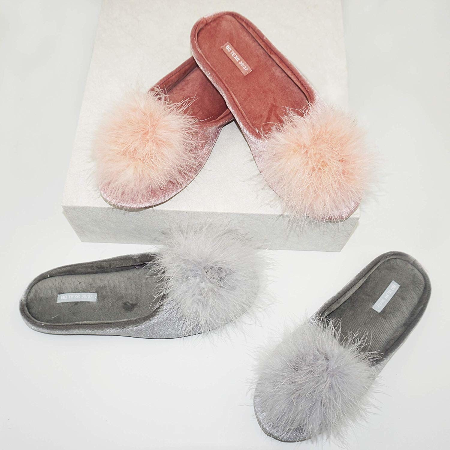 The slippers in blush pink and grey