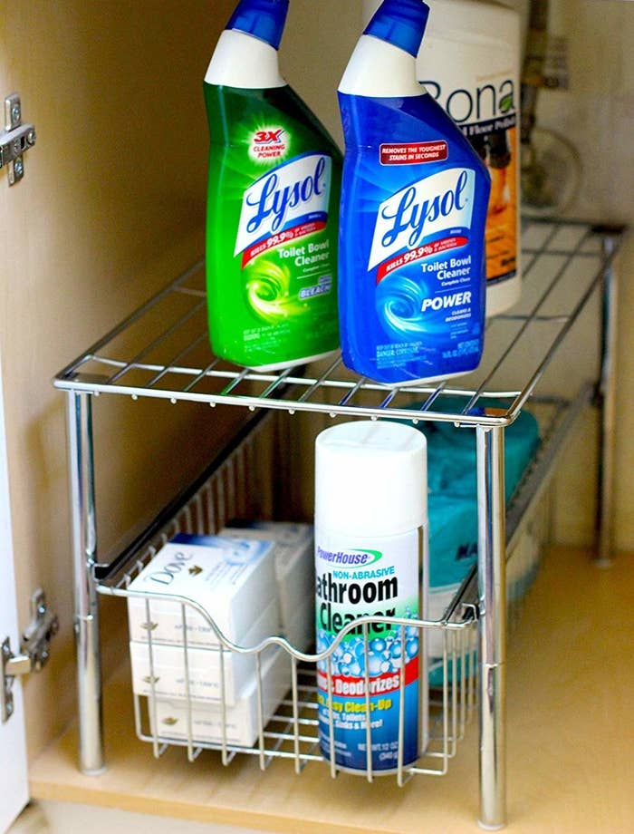 The two-tiered shelf, which can hold several bottles of cleaner, bars of soap, and toilet paper with room to spare