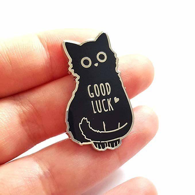 "Promising review: ""Soooo cute! Got it for my backpack. Has nice metal backings and is very good quality. I found a black kitten recently and have since kept her, so this pin is like I'm able to have a little piece of my kitty!"" —AlinaGet it from Amazon for $9.99."