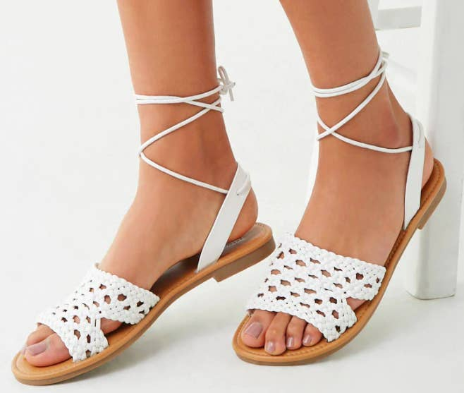 93be1540b5 A pair of faux leather open toe sandals designed with a basketweave design  and lace-up strap for all your summer BBQ footwear needs.