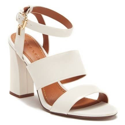 a73fc29725 A pair of leather block heel Coach sandals comfy enough to walk around in  all summer long.