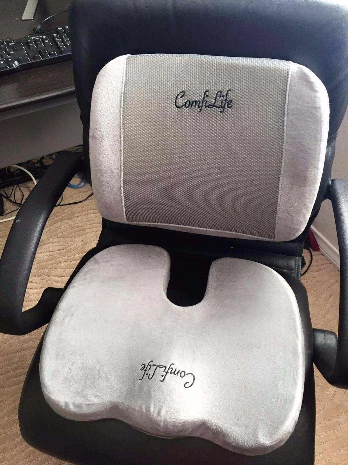 the seat cushion and lumbar pillow placed on a black computer chair