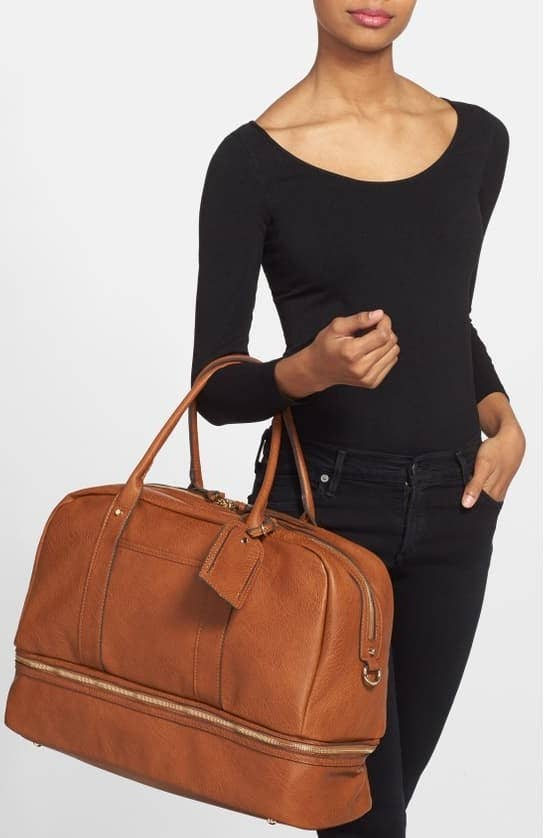 It also has a two-way zip closure, removable handles, an adjustable shoulder strap, and multiple pockets. Get it from Nordstrom for $89.95 (available in five colors).