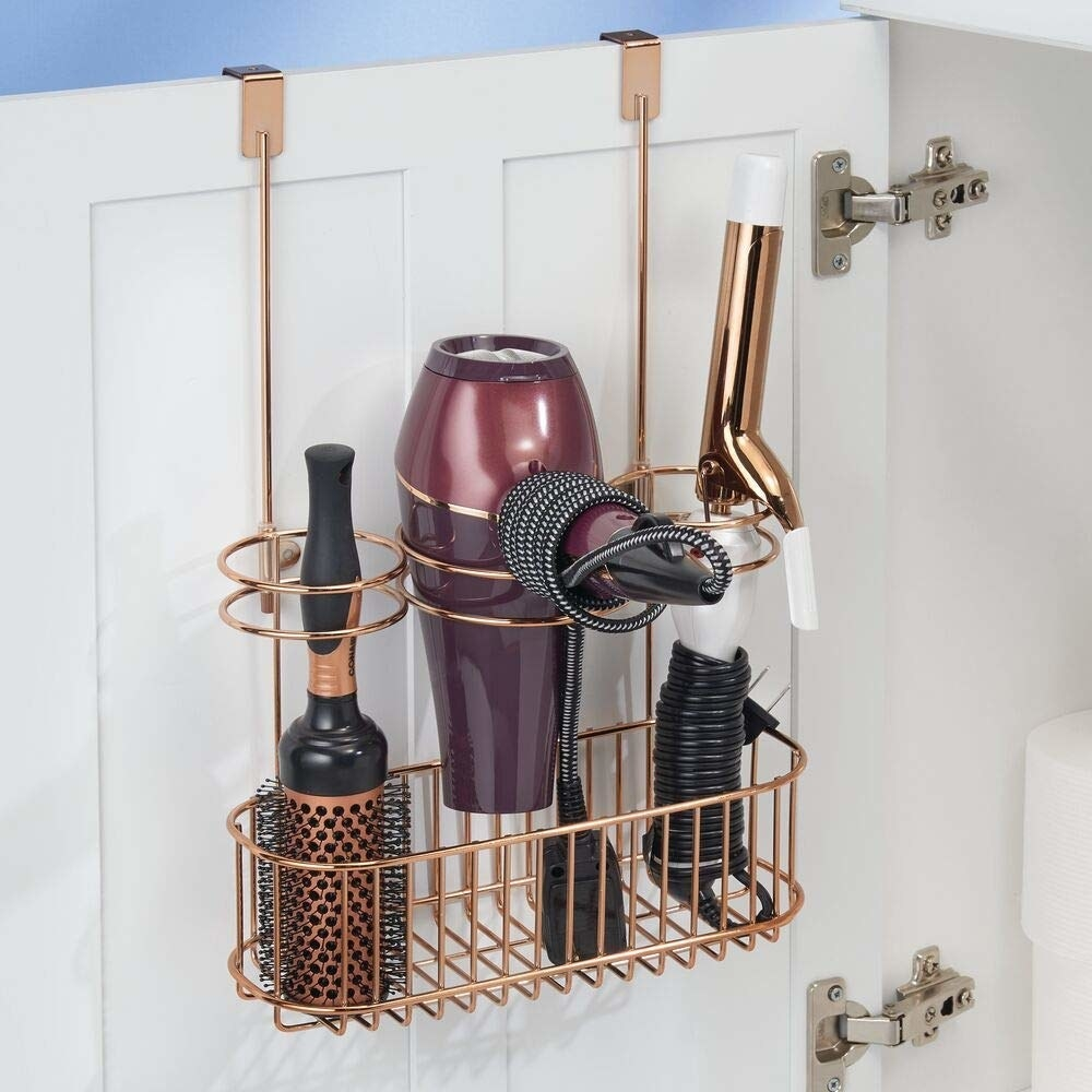 The organizer in copper; it's holding a round brush, a hair dryer, and a curling iron but has space to hold even more