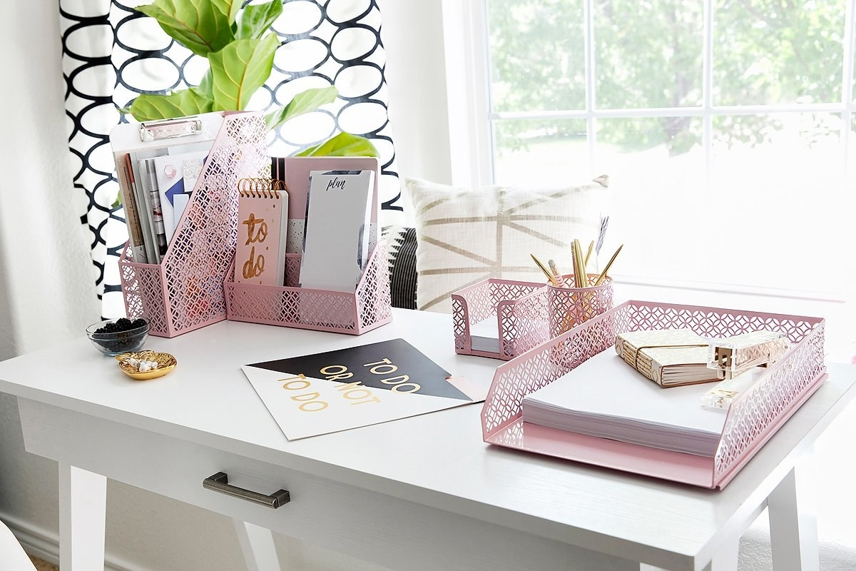 The set in pink on a desk; it has a pretty almost floral mesh pattern