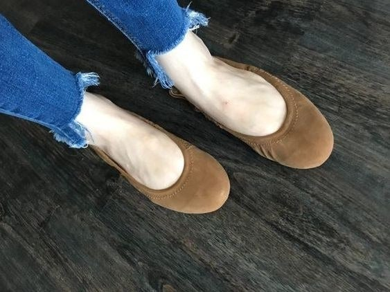 person wearing ballet flats with skinny jeans
