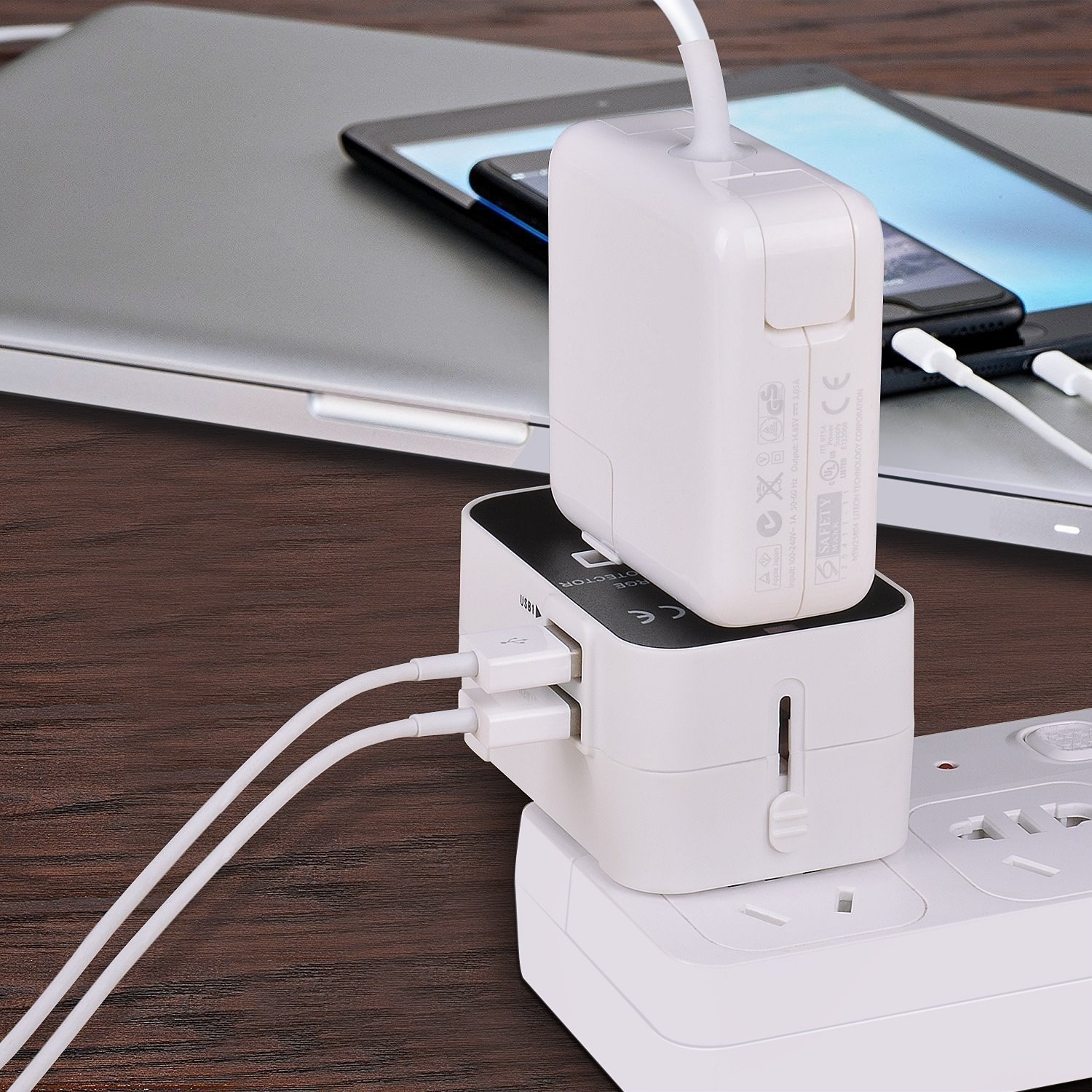 universal travel adaptor with two cords plugged into it