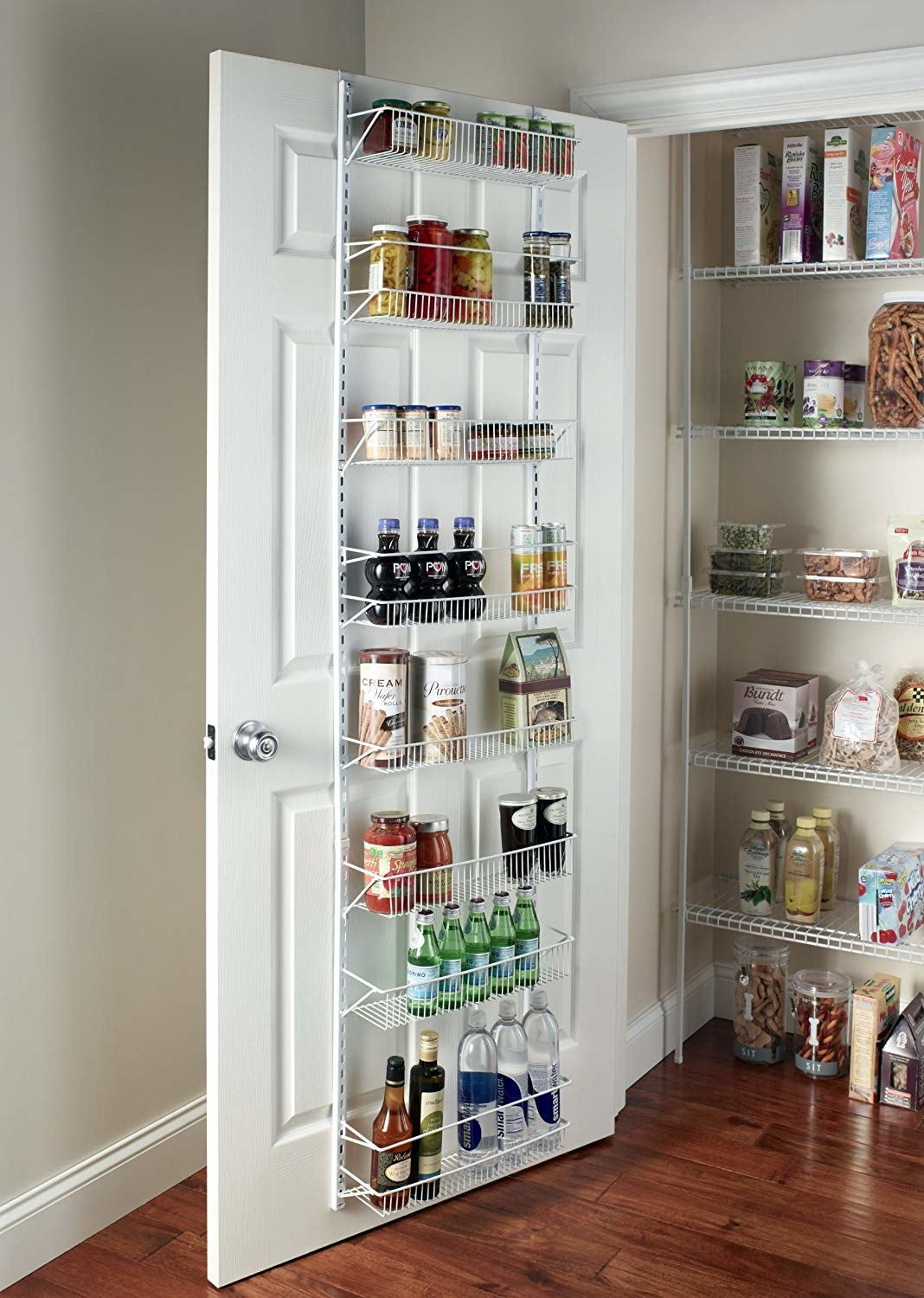 The white rack, with 8 shallow baskets spaced between the bottom and top of the door that fit things like jars of pasta sauces and boxes of snacks, hung on the back of a pantry door