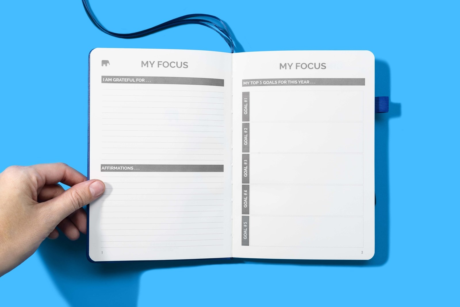 """The inside of the notebook on a """"my focus"""" page, where you list what you're grateful for, affirmations, and check in on your goals"""