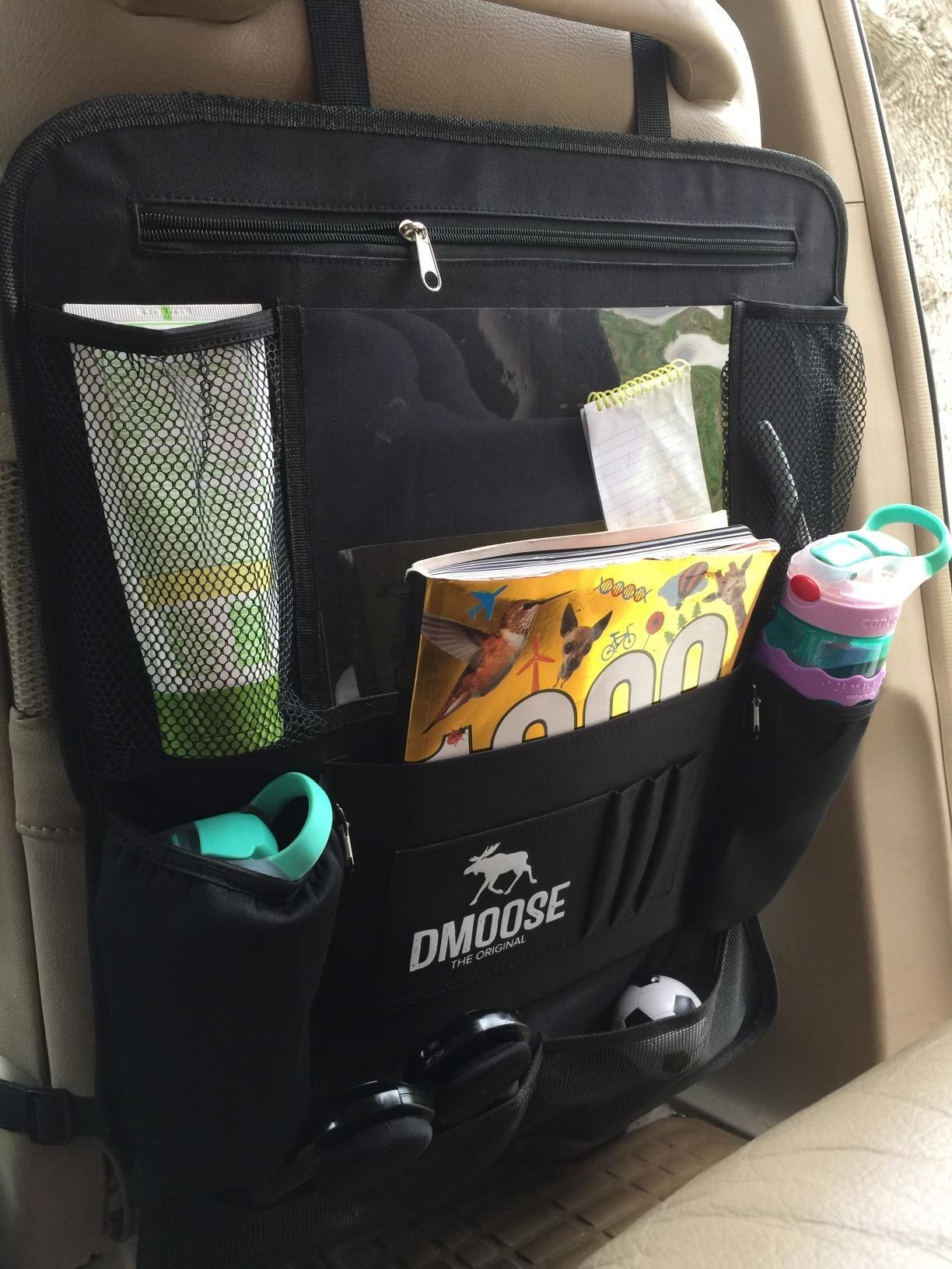 The backseat organizer, which has a touchscreen tablet holder and drink pouches
