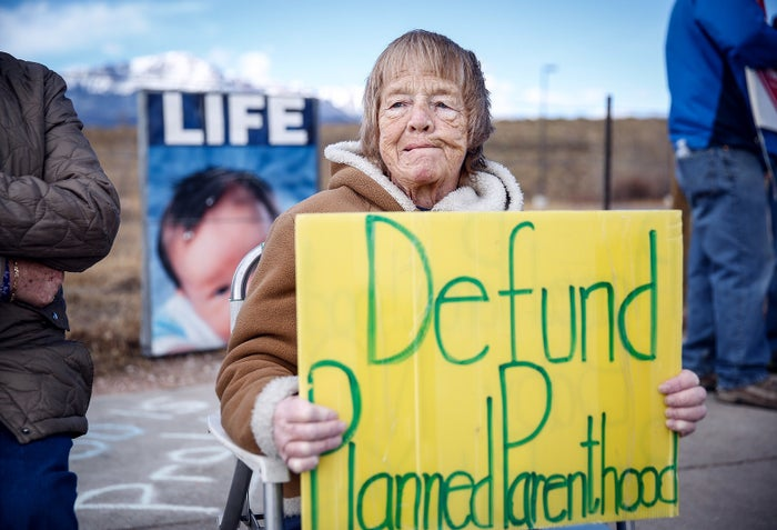 An anti-abortion protester holds a sign while demonstrating outside the Colorado Springs Westside Health Center on Feb. 11, 2017.