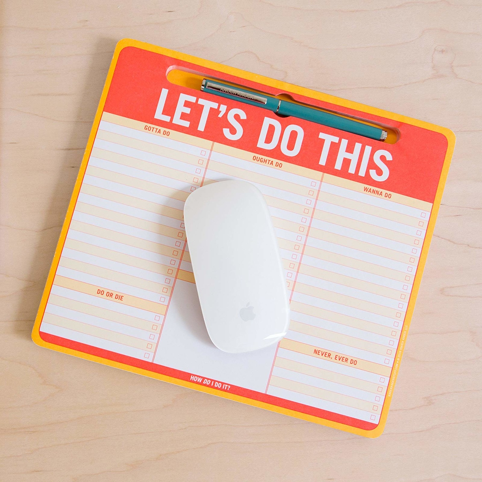 "The pad reading ""LET'S DO THIS"" with a mouse on top"