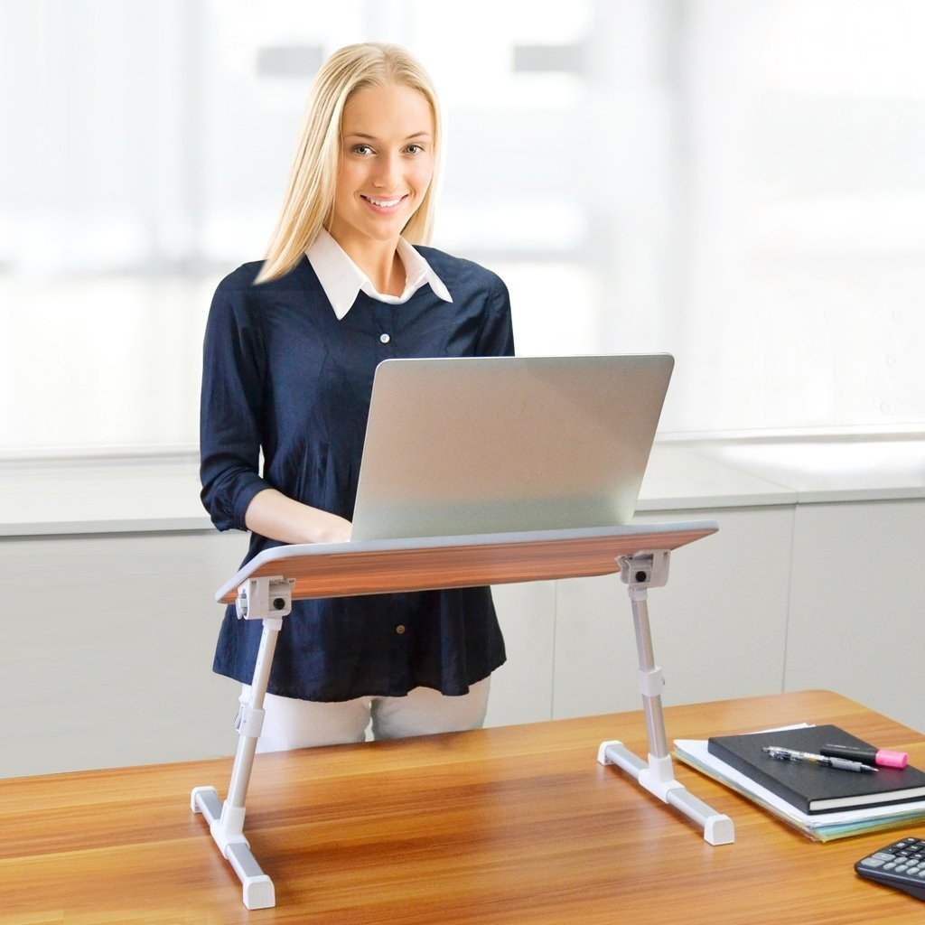 Model using a laptop at the standing desk