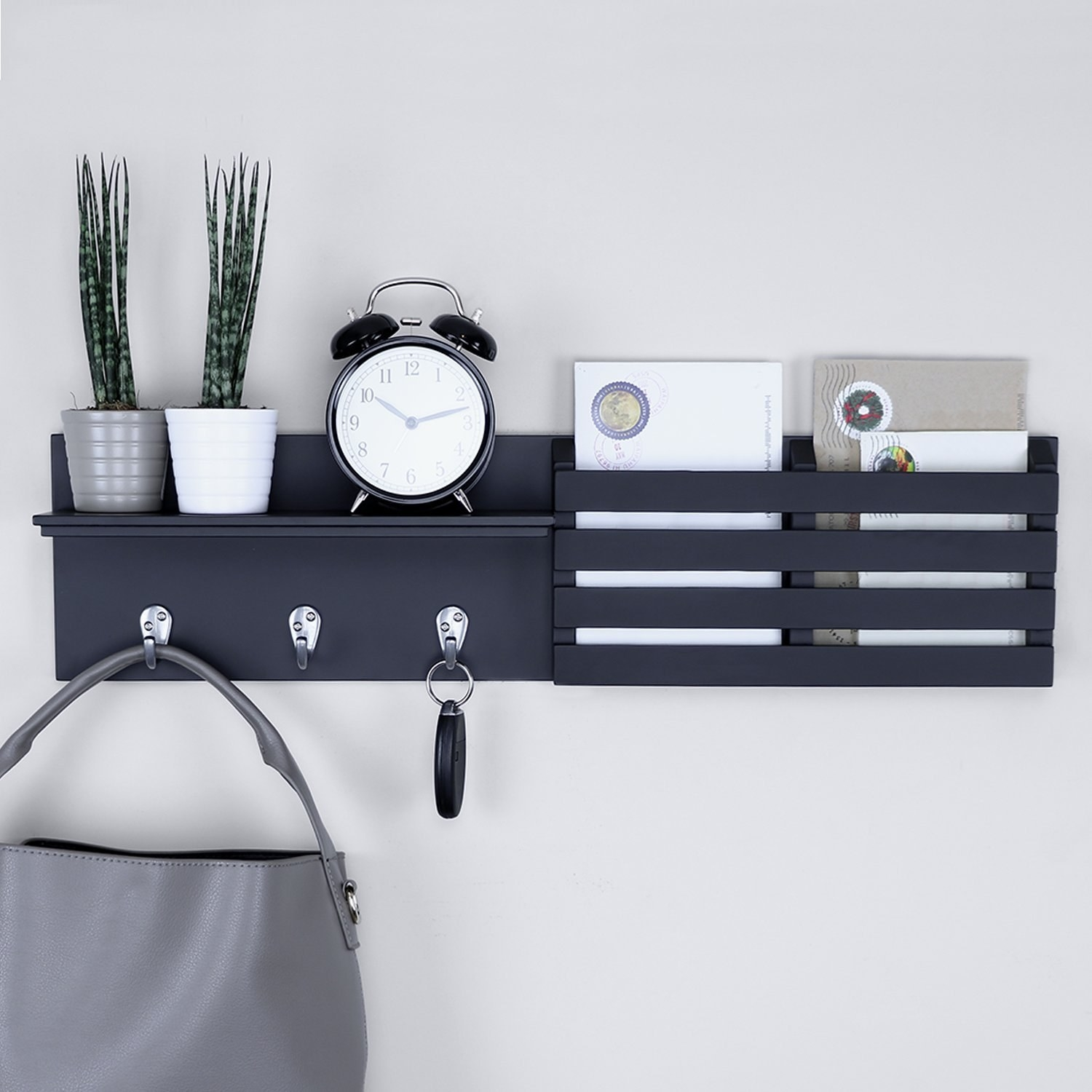 The three-part organizer: it has a small shelf and three small hooks on one half; and two narrow bins made for mail on the other