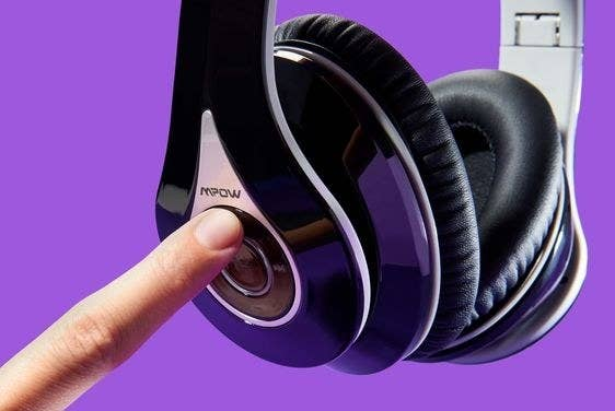 Closeup of the headphones with a finger pressing the conveniently located buttons