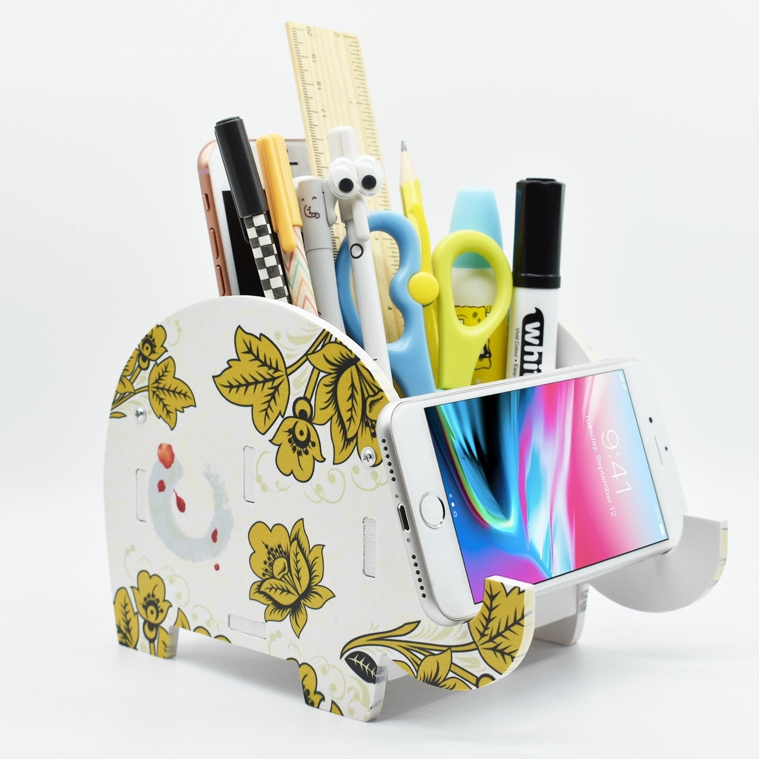 The organizer holding a phone, pens, pencils, markers, scissors, a ruler, and more